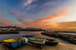 Barcas de pesca y atardecer desde el puerto de sardina del Norte